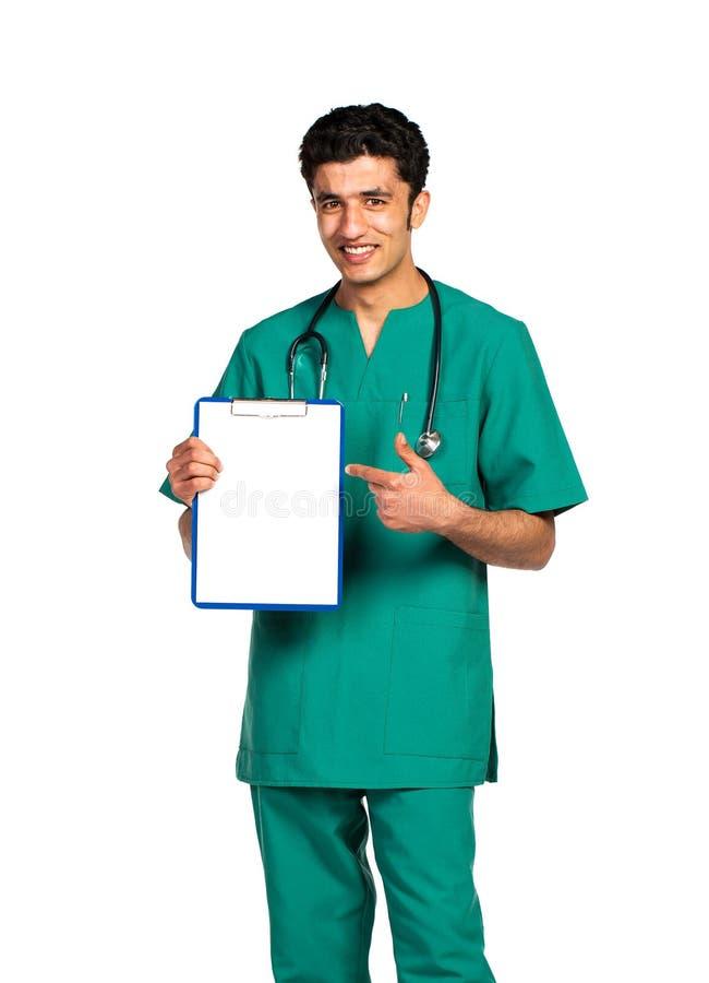 医生阿拉伯国籍画象与健康记录的在白色 库存照片