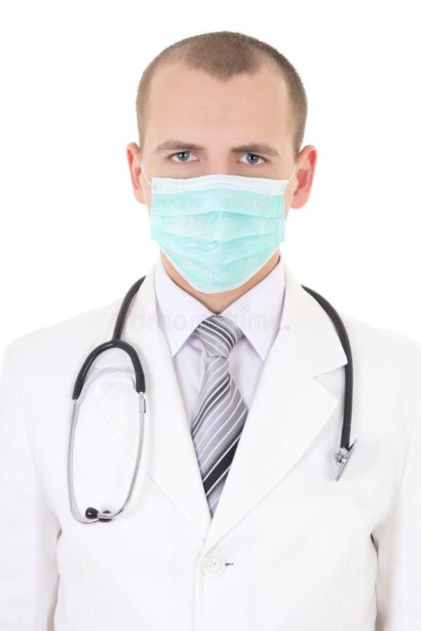 年轻医生画象在白色隔绝的面具的 库存照片