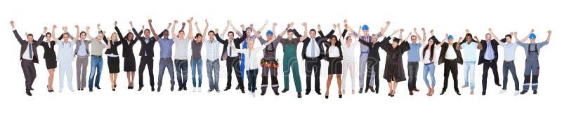 用不同的职业的激动的人庆祝成功的 库存图片