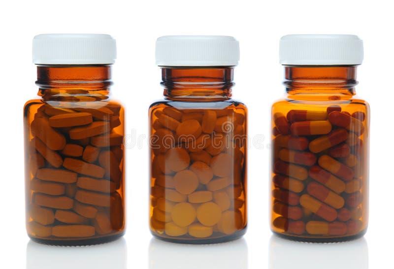 用不同的药物的三个布朗医学瓶 免版税库存照片