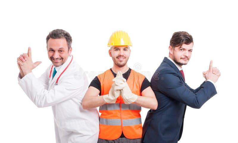 用不同的行业的三个人 库存照片