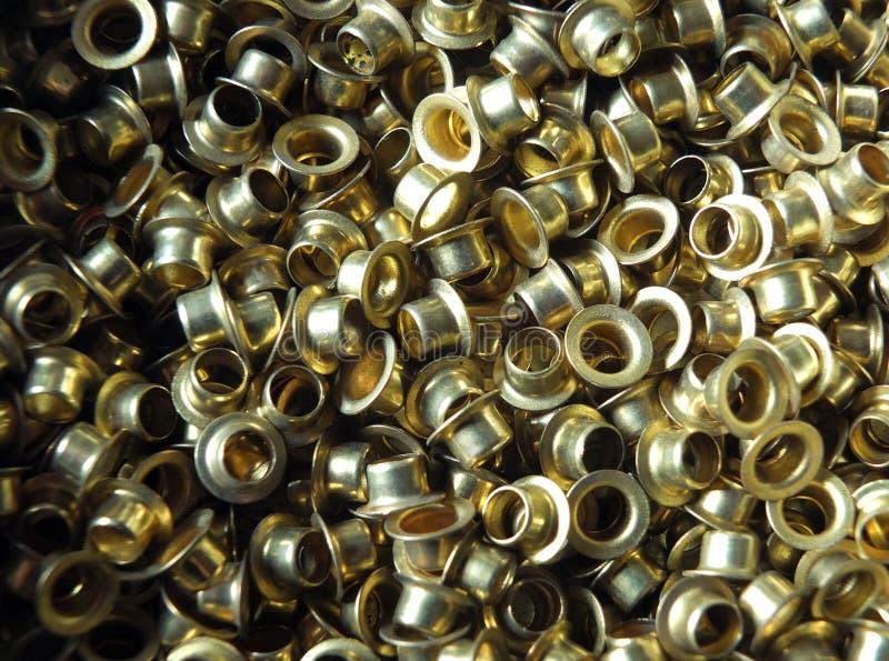 用于时尚和皮革的黄铜圆小孔运作 库存图片