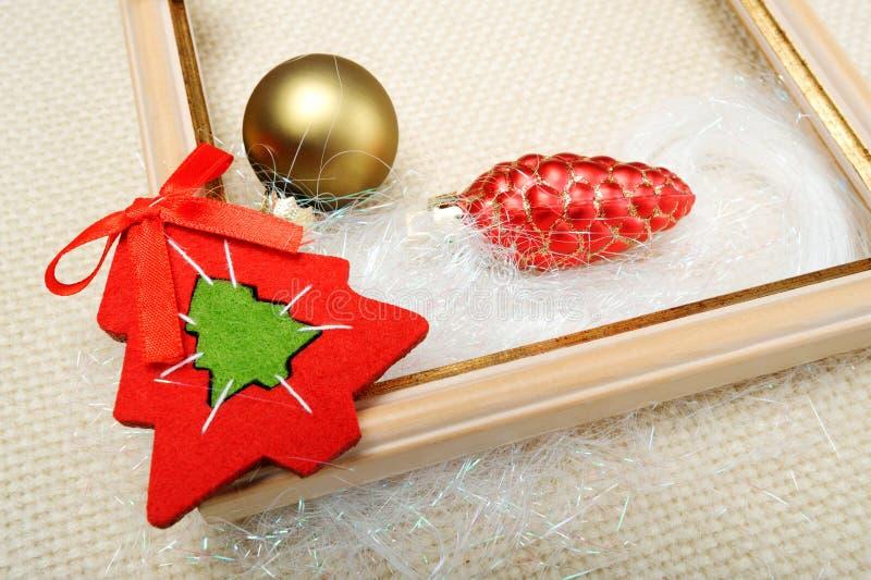 Download 用圣诞节装饰的画框戏弄特写镜头 库存图片. 图片 包括有 节假日, 粉红色, 编织, 问候, 锥体, 空白的 - 62529613