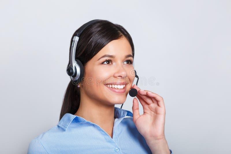 用户支持耳机的电话操作员,有口号或正文消息的空白的copyspace区域的,在灰色背景 图库摄影