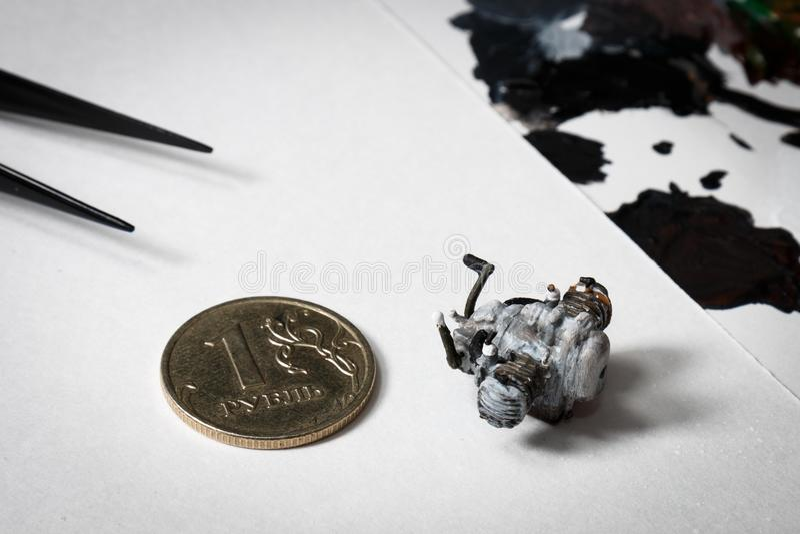 用手被绘的摩托车引擎塑料模型 图库摄影