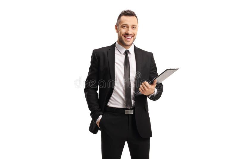 用文档夹持剪贴板的商人 免版税库存图片