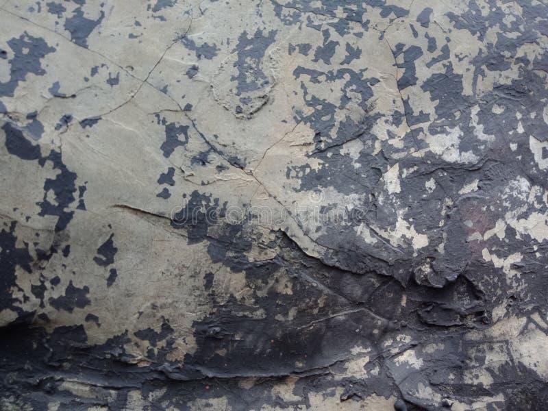 用水泥涂墙壁构造与灰色和黑色被遮蔽的背景墙纸, 免版税图库摄影