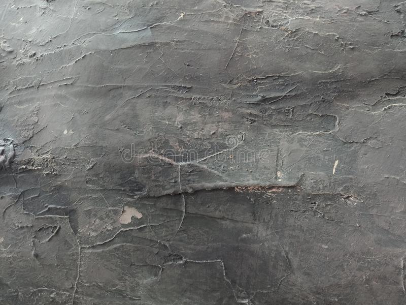 用水泥涂墙壁构造与灰色被遮蔽的背景墙纸, 库存照片