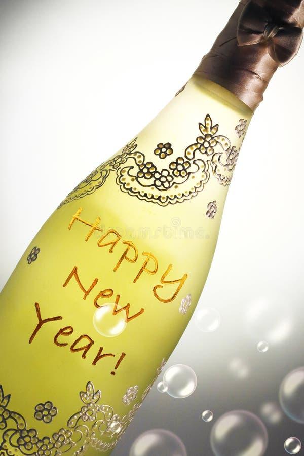 用消息非常恰好装饰的香宾瓶新年快乐 库存图片