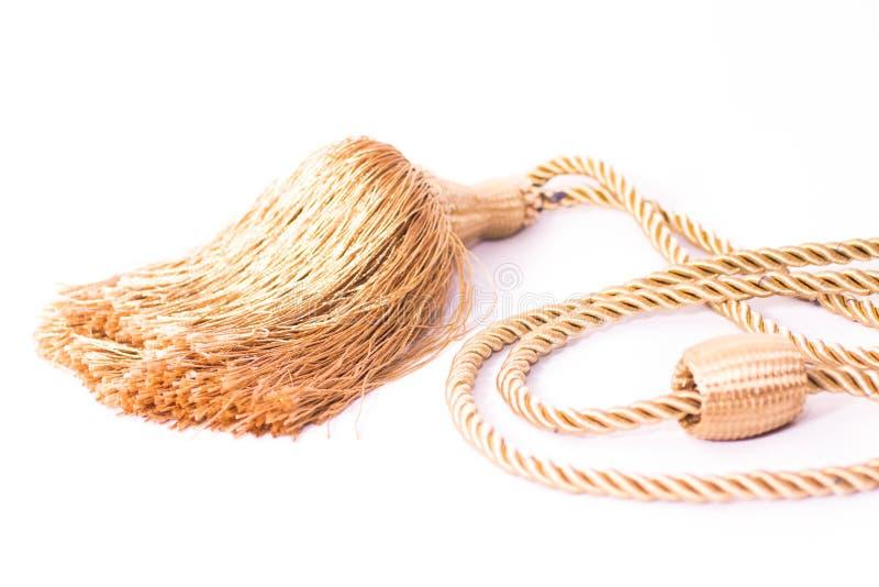 用漂亮针织绳进行室内装饰的蓬松白色套囊 免版税图库摄影