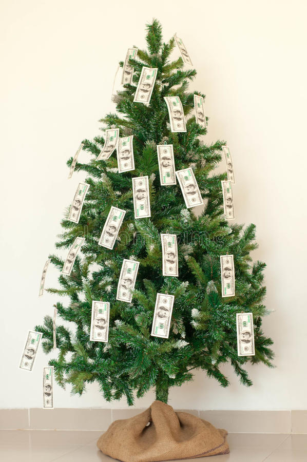用美元笔记装饰的圣诞树 图库摄影