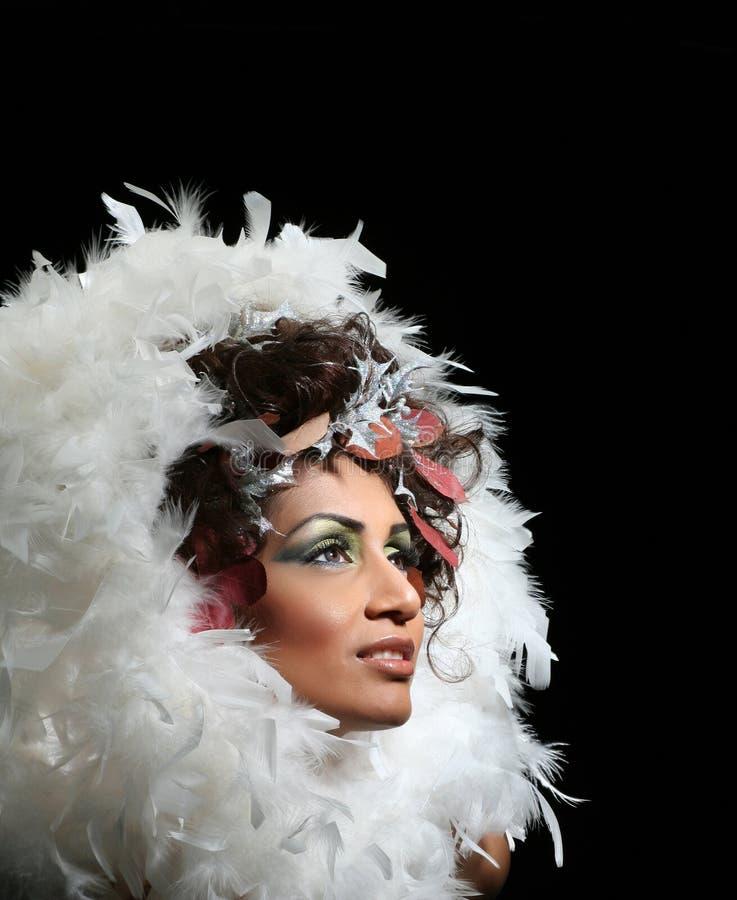用羽毛装饰妇女 免版税库存图片