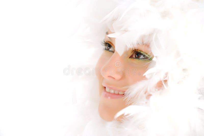 用羽毛装饰白人妇女年轻人 库存照片