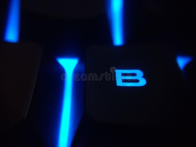 由后面照的蓝色被带领的键盘b 图库摄影