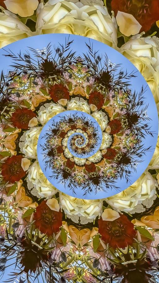 由在圆安排的花做的垂直的螺旋形状在婚礼在加利福尼亚 免版税图库摄影