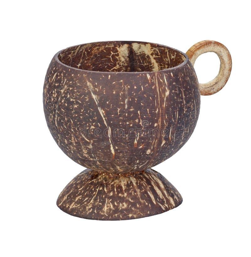 由椰子壳做的杯被隔绝在白色 免版税库存图片