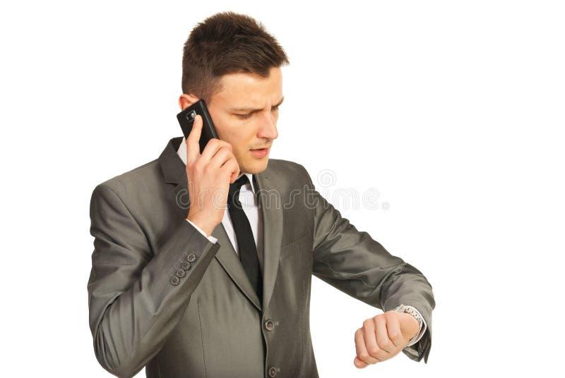 由电话移动电话的强调的商人 库存照片