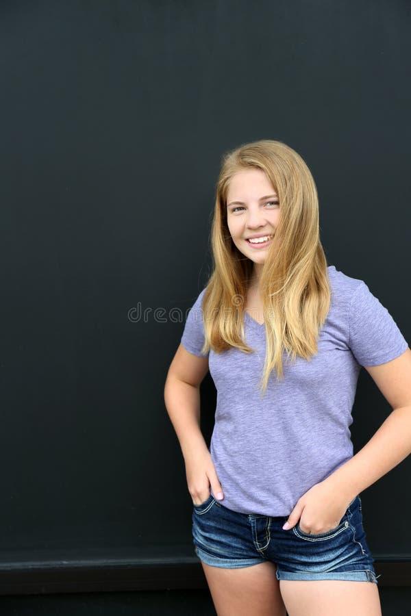由黑板的女孩 免版税图库摄影