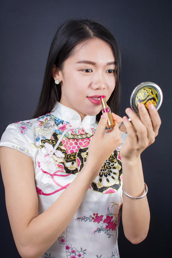 申请构成的美丽的年轻亚裔妇女 库存照片