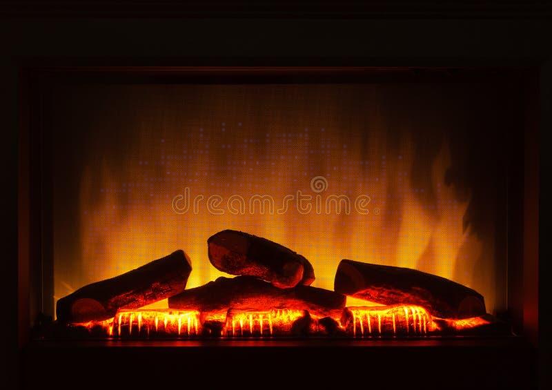 电人为壁炉橙色火内部特写镜头  免版税库存图片