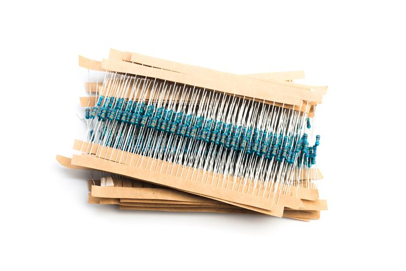 电子元件:在白的图象在纸带的电阻器隔绝的 免版税库存照片