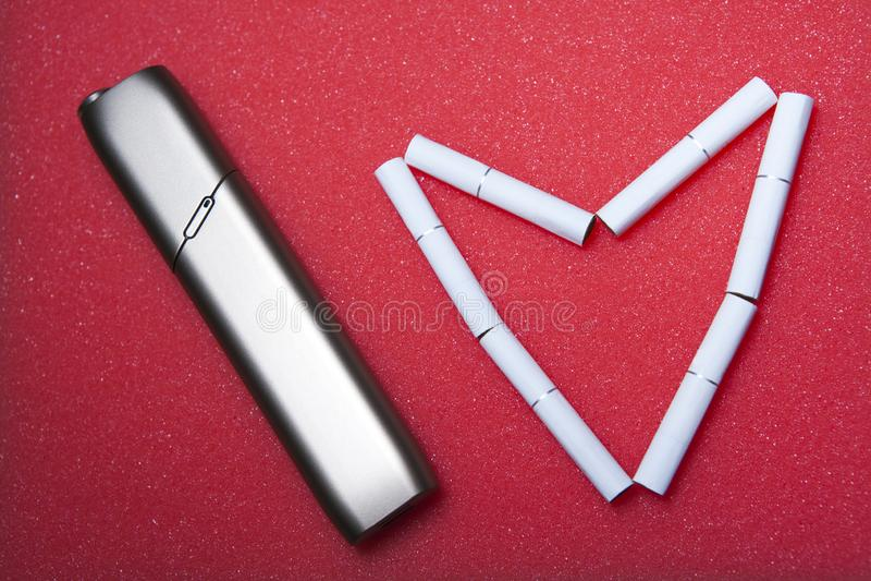电子烟设备心脏标志没人 免版税库存照片