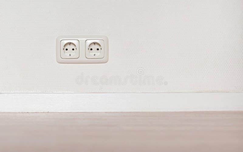 电子起重器白色塑料插口 库存图片