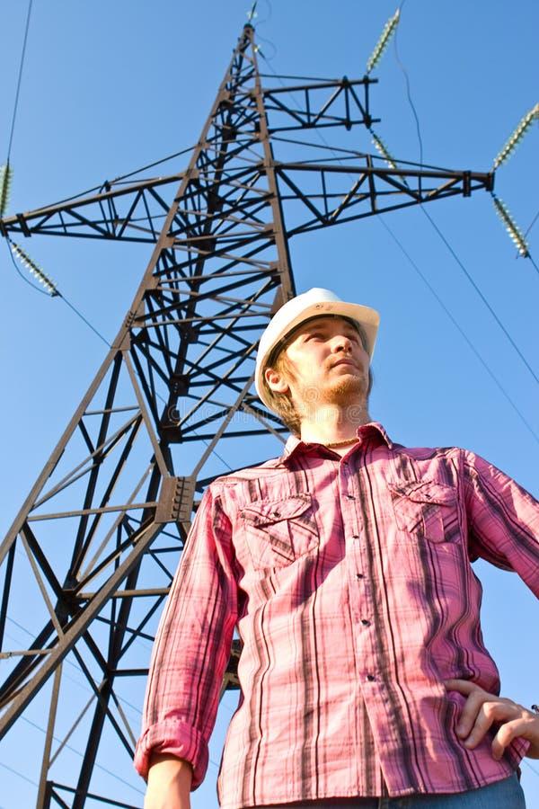 电定向塔的电工 库存图片
