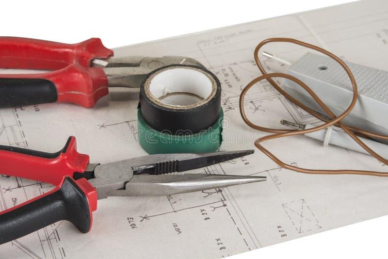 电工用工具加工钳子和少年和电压米 免版税库存照片