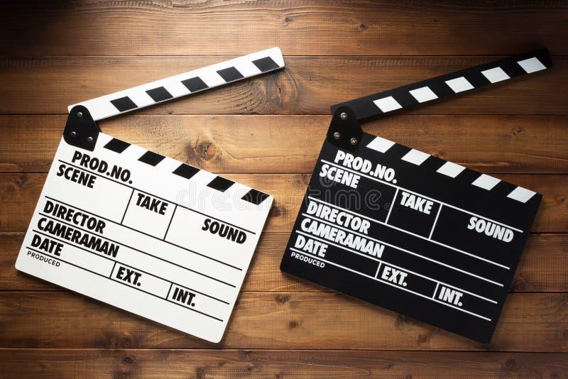 电影在木背景的拍板 库存图片