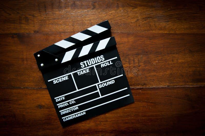 电影在木头的拍板 库存照片