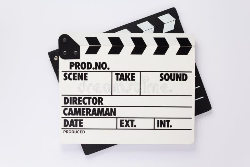 电影在白色背景的拍板 库存照片