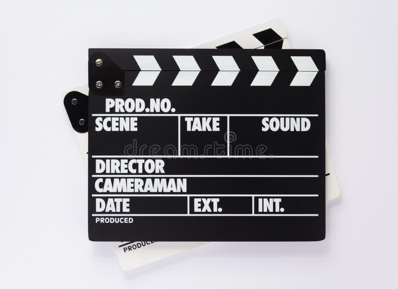 电影在白色背景的拍板 库存图片