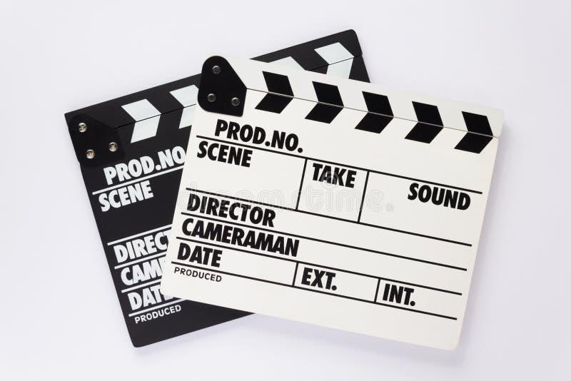 电影在白色背景的拍板 免版税库存图片