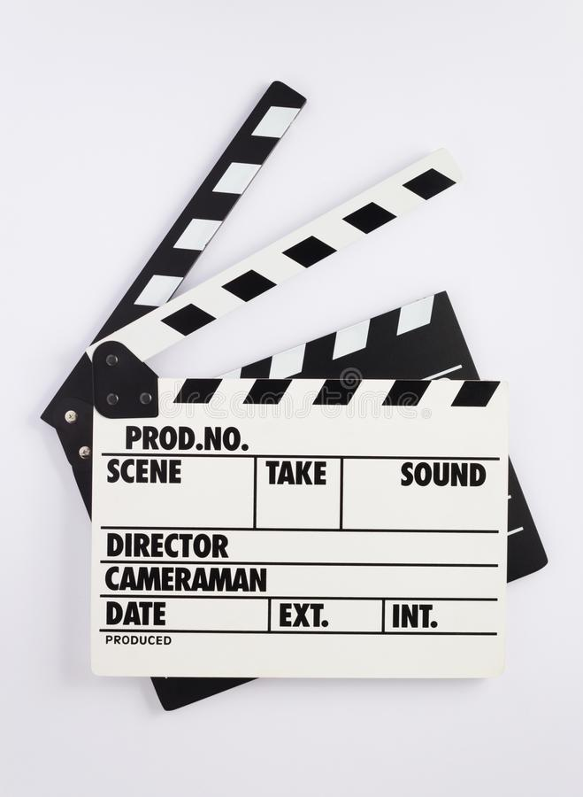 电影在白色背景的拍板 图库摄影