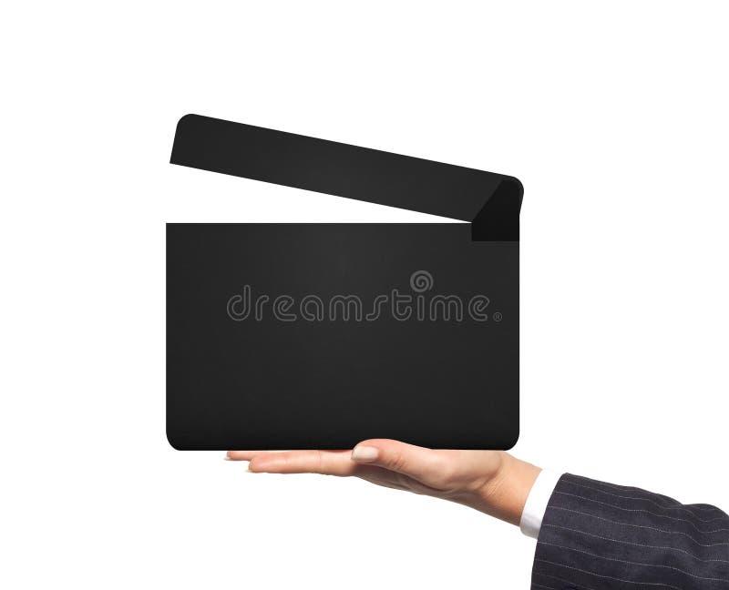 电影clapperboard在白色隔绝的妇女手上 免版税库存图片
