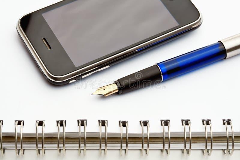 电池笔记本笔电话 免版税库存图片