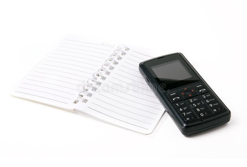 电池记事本电话 免版税库存照片
