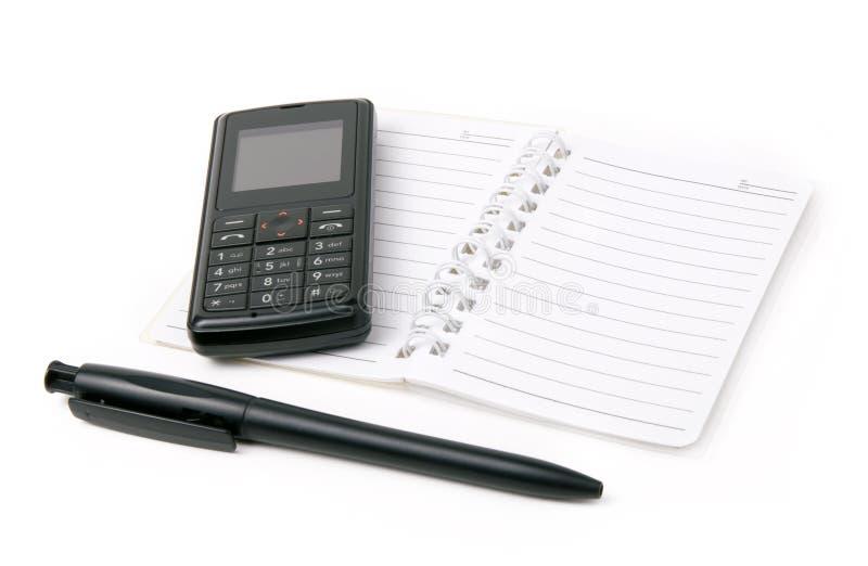 电池记事本笔电话 免版税库存图片