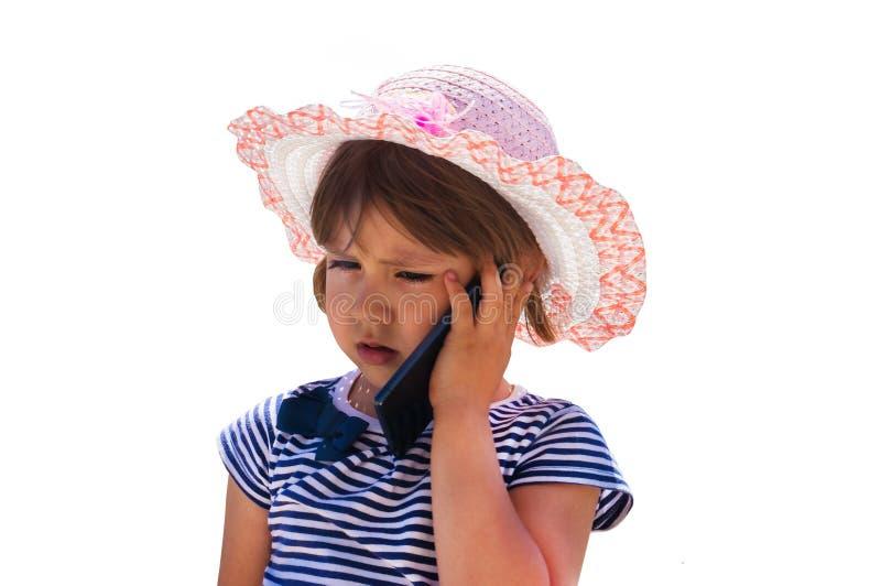 电池逗人喜爱的女孩一点电话告诉 库存照片