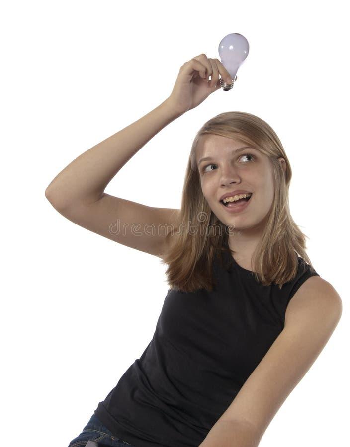 电灯泡女孩有在少年的顶头想法光 免版税库存照片