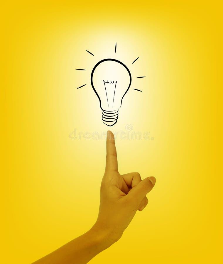 电灯泡指尖光妇女 库存照片