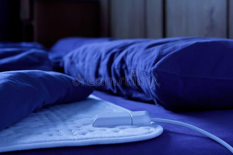 电热化毯子垫床 库存照片