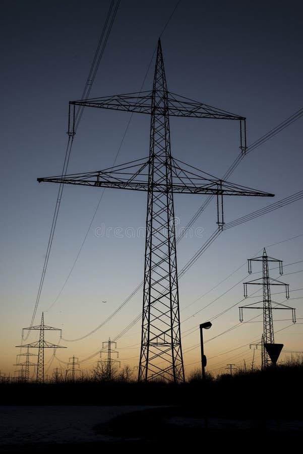 电线钢塔风景日落日出黎明剪影 库存图片