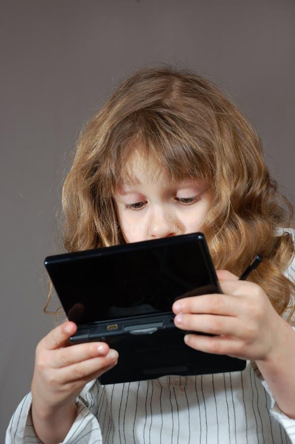 电脑游戏孩子使用 免版税库存照片
