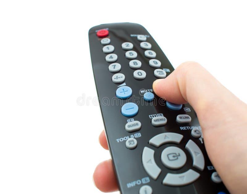 电视遥控手中被隔绝的特写镜头 库存图片