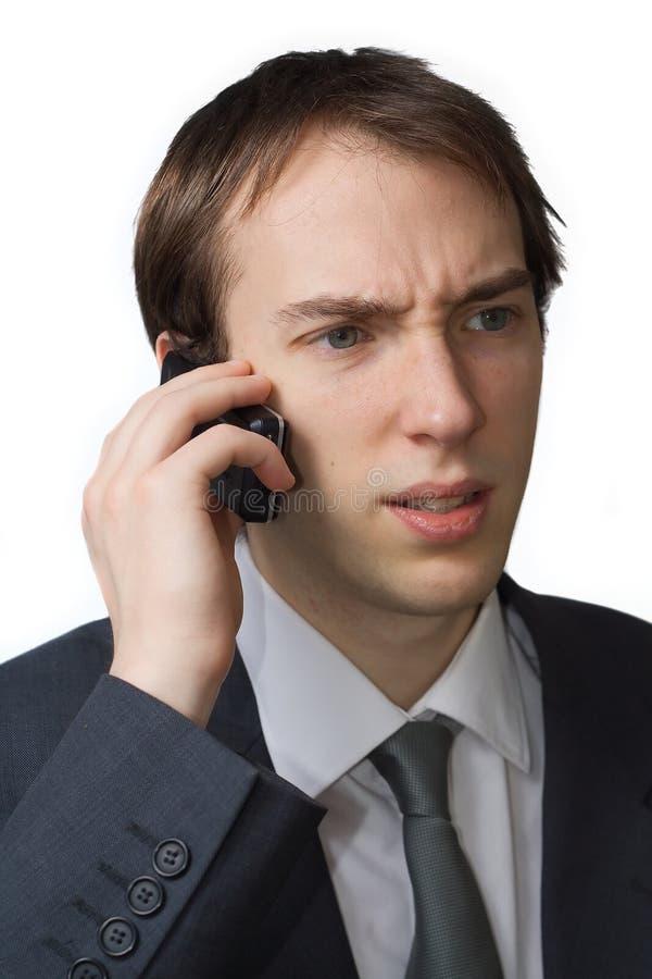 电话专业担心的年轻人 免版税图库摄影