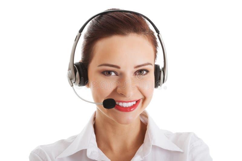 电话中心的美丽的妇女与话筒和耳机。 库存照片