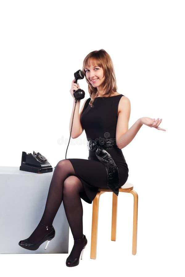 电话减速火箭的妇女年轻人 库存图片