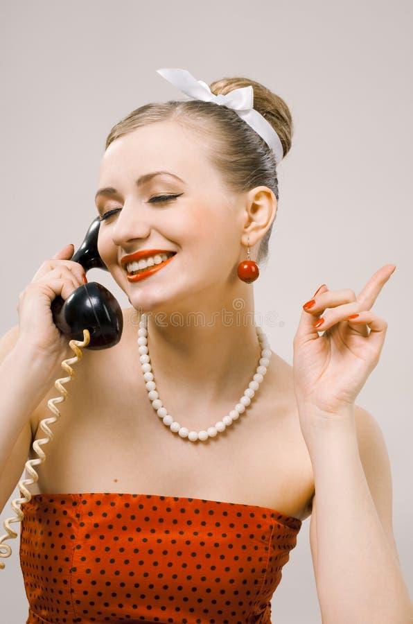 电话减速火箭的妇女 图库摄影